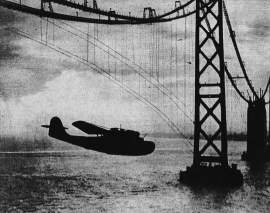 Clyde Sunderland &nbsp&nbsp China Clipper flies under the Bay Bridge while the bridge was still under construction. The weight of the mail on board the plane did not allow Pilot Ed Musick to ascend sufficiently to fly over the bridge.