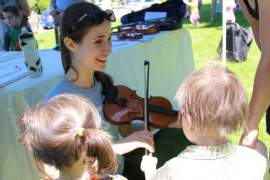 A string academy member demonstrates the violin. Courtesy photo