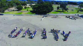 "Courtesy Alain McLaughlin &nbsp&nbsp Alamedans gathered for the annual Unity Picnic and took this drone shot this past Saturday. They stood in formation to spell ""unity"" from above."