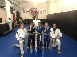 File Photo &nbsp&nbsp Sergio Silva (back row) posed with students and instructors from his Park Street studio. Silva helped host the Jiu-Jitsu by the Bay Tournament in September.
