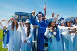 Photo by Maurice Ramirez - EHS graduates finding their families in the crowd.