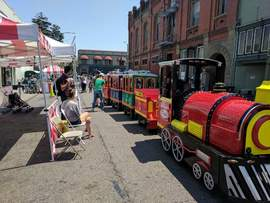 Photos courtesy Downtown Alameda Business Association &nbsp&nbsp Last weekend's Art & Wine Faire provided fun for thousands of visitors to Downtown Alameda. The kids' section on Alameda Avenue offered rides including a festive passenger train.