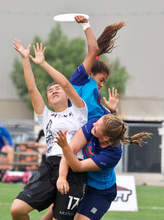 Andrew Carothers-Liske &mnsp&nbsp Robin Anthony-Petersen leaps over teammate Lauren Carothers-Liske and a New Zealand opponent to grab the disc for the U.S. Ultimate Team.