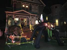 Betty Young &nbsp&nbsp Near Grand Street, trick or treaters approached a house by ducking under a giant black cat.