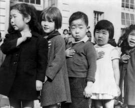 .S. National Archives & Records Administration photo by Dorothea Lange &nbsp&nbsp First-graders, some of Japanese ancestry, at the Weill public school in San Francisco pledge allegiance to the U.S. flag prior to their removal in April 1942.