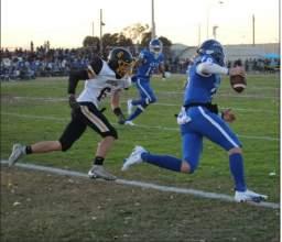 Encinal High quarterback Garrett Deatherage eludes  the Alameda High defender to run for a 12-yard gain  in the first quarter.