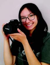 Katrina Chan poses with her camera, the tool of her craft.