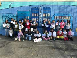 Courtesy Edison Elementary School &nbsp&nbsp Edison Elementary School students from Kate Flanagan's fifth-grade class display the art they created to send to students affected by the Butte County fires.