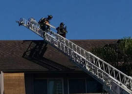 Jay Kayy Cismowski - A pair of firefighters investigate the fire that started in a utility room of an apartment building on Shore Line Drive last Sunday. An investigator determined that an malfunctioning pool heater caused the blaze.
