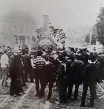 Robert S. Ford Collection - Croll's Hotel looms in the background as a curious crowd gathers around Southern Pacific Railroad's engine #2088 on the morning of Jan. 15, 1903. Boiler tubes jut out of the locomotive after it exploded.