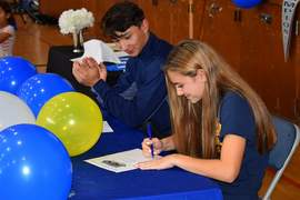 Courtesy photo &nbsp&nbsp Encinal High School seniors Alex Olaes (left) and Shelby Nelson made their college choices clear at a ceremony held May 22. Olaes will play baseball for Menlo College and Nelson will compete in cross country for UC Santa Barbara.
