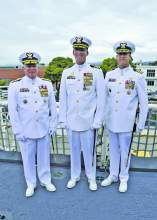 Petty Officer 2nd Class Matthew Masaschi  &nbsp&nbsp&nbsp&nbsp Coast Guard Pacific Area Commander Vice Adm. Fred Midgette, Capt. Nathan Moore and Capt. Craig Wieschhorster (left to right) stand aboard the Coast Guard Cutter Stratton following a change of command ceremony last Thursday.