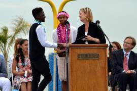 Alameda Education Foundation &nbsp&nbsp&nbsp AEF Executive Director Vicki Sedlack presents the Jack Capon award to Encinal Jr. Jets recipients Brian Oduor and Sonia Randall at their eighth-grade promotion on June 8.