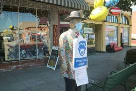 Dennis Evanosky &nbsp&nbsp The statue of Jack Daniel in front of Lost City Antiques on Park Street reminds passersby to be certain to wear their masks when they shop. Many stores and restaurants in Alameda opened last Friday for business