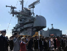 File photos &nbsp&nbsp In July the USS Hornet played host a ceremony welcoming new citizens to the United States.