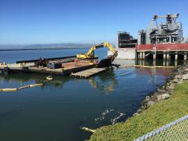 Irene Dieter  Construction crews recently placed a new haul-out at Alameda Point harbor seals can use as a place to rest.