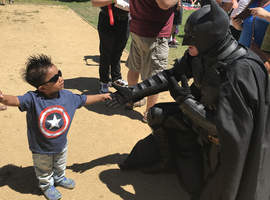 Courtesy photo &nbsp&nbsp Little Allie meets Batman at a special picnic celebrating his ongoing recovery from a liver transplant that helped save his life more than two years ago.