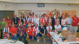 Courtesy photo &nbsp&nbsp Alamedan Susanne La Faver stands among some of the many Red Cross volunteers at the Ranch Fire that continues to burn in Lake County.
