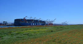 Richard Bangert &nbsp&nbsp&nbsp A ship from the French container transportation and shipping company CMA CGM S.A. on the Oakland Estuary provides the backdrop to property that is part of a recent land deal for the city.