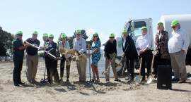 Photo by Dennis Evanosky. Members of the City Council join fellow community leaders to break ground for the first phase of Estuary Park on Mosley Avenue on the West End.