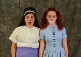 Courtesy photo Cienna Johnson as Tracy Turnblad and Nicolette DeLong-Silva as Penny Pingleton.