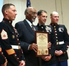 Courtesy photo. His fellow marines flank Benjamin Jenkins as he displays his Congressional Gold Medal certificate.