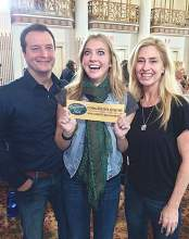 Alameda Police Chief Paul Rolleri and his wife, Karen, flank ther daughter Rachel as she shows off her Goldern Ticket to American Idol.