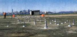 The San Francisco skyline serves as backdrop for a network of wells that the Navy installed at Site 1. US Navy photo