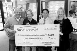 Courtesy photo &nbsp&nbsp Left to right, Bill Sonneman, Alameda Education Foundation president; Vicki Sedlack, Alameda Education Foundation executive director; Dr. Daniel Chin, OD; and Vicky Schiffer, ABB Optical Group account manager celebrate the group's recent donation to Alameda schools.