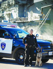 Alameda Police Department &nbsp&nbsp Alameda Police Department Officer Vanessa Dubon stands at the ready with her Police Service Dog Argo — a German Shepard from Slovakia. Dubon and Argo have worked together for more than four years. They are certified for both patrol tactics and narcotic detection.