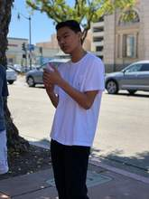 Courtesy photo &nbsp&nbsp Student Director Cameron Furuichi-Fong, a member of the Board of Directors of the Alameda Sister City Association, spoke to a group of Alamedans mourning recent gun violence. Furuichi-Fong is a junior at Encinal High School.