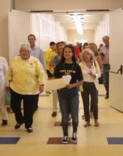 Dennis Evanosky &nbsp&nbsp Bella Puchkova, Alameda High School Class of '20, leads a tour through the newly refurbished school.