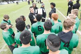 Courtesy of Oakland Raiders &nbsp&nbsp Oakland Raiders starting quarterback Derek Carr instructs local football youth at the Raider U event Thursday, June 7, at the Oakland Raiders team practice facility in Alameda. Members of the Encinal High football team were among players from eight East Bay teams that participated.