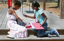 Courtesy Alameda Point Collaborative  Young girls at the Alameda Point Collaborative check out their new backpacks and school supplies from the 2015 school supply drive.