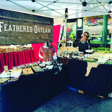 Courtesy photo &nbsp&nbsp In a true display of cross-Island camaraderie, Feathered Outlaw, a Webster Street business, participated in last weekend's Art & Wine Faire on Park Street. Given the boutique's penchant for purveying local art, Park Street's event proved a good fit.