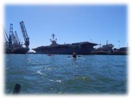 Courtesy photo  Kayakers can enjoy the feeling of being dwarfed by the Navy ships docked at Alameda Point