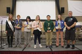 Chuck Kapelke &nbsp&nbsp The city's poets laureate and spelling bee judges flank the top five spellers in last Saturday's competition. Left to right: Cathy Dana, Thomas McMuldren, Adriana Argyriou, Ella Banchieri, Vincent Gao, Elizabeth Tsyvinsky and Gene Kahane.