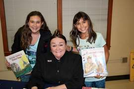 Courtesy photo &nbsp&nbsp Author and illustrator Patricia Polacco released her new book, Remembering Vera, which is set on Alameda's Coast Guard Island, at Earhart Elementary School on Monday, Oct. 2. Here she is flanked by local fans Lily and Bella Deleon.