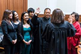 Courtesy photo &nbsp&nbsp Gov. Jerry Brown appointed Alameda native Benjamin Reyes II Contra Costa County Superior Court Judge in May. Above, Reyes takes the oath of office from Chief Justice Tani Cantil-Sakauye while surrounded by his family. Reyes' sister, Assistant City Clerk for the City of Alameda, Irma Glidden, appears at far left.