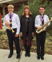 Courtesy photo  Jack Pace, left, and Nick Yajko, right, flank Lincoln Middle School music director Tyra Cable. The student musicians represented Lincoln Middle School at the recent California Music Educators Association Winter Conference.
