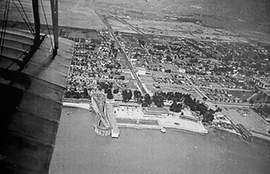 File photo &nbsp&nbsp Alameda's Neptune Beach as it appeared from the sky in 1920 contains the site of today's McKay Avenue. At the left of the amusement park, the helix-shaped roller coaster known as the Scenic Railway takes up the spot that would one day become McKay. Much of Crab Cove and the end of McKay are built on made land created by the Strehlow family that owned and operated Neptune Beach. The entrance to the park was at Webster Street and Central Avenue, hidden behind trees in the photo.