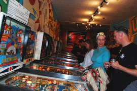 """Photo by L.D. Freeman &nbsp&nbsp Elisa and Ben Holt of Alameda combine to flip and sip during Bay Area Beer Week at the Pacific Pinball Museum's """"Pinball and Pints."""" The event offered a fine brew of two American cultural mainstays. Elisa had Ben on the ropes until his last ball on cowboy-themed """"Buckaroo."""""""