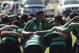 The Alameda Islanders rugby team huddles up.