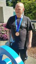 Courtesy Photo &nbsp&nbsp Encinal High alum Charles Scanlon won three medals at the Special Olympics USA Games.