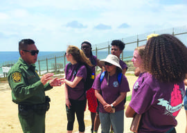 Courtesy photo &nbsp&nbsp Students from Alameda meet with a U.S. Border Patrol officer on a special trip this summer to learn about public service.