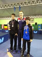 Courtesy Photo &nbsp&nbsp Kai (left) annd Aziz (right) Zarehbin celebrate winning two bronze medals with their coach Rajko Gommers at the Slovak Cadet Table Tennis Open.