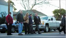 File photo &nbsp&nbsp Pedestrian safety is not a new issue for Alameda. Frank Muñoz (center, with cane) crossed Lincoln Avenue with some help from friends: (from left to right) Cindy Zecher, Laura Hudgins, Gary Lym and Sean McPhetridge. The crossing in February 2017 drew attention to the fact that Muñoz had been struck by a car after three other cars had stopped at the crosswalk on Lincoln Avenue near Benton Street.
