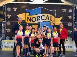 alamedasoccer.org &nbsp&nbsp The Alameda Islanders 2009 girls red team celebrate their second-place trophy at the NorCal Premier State Cup Sunday, Jan. 27. The team went 3-1 in the two-day soccer tournament.
