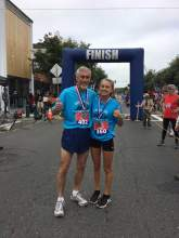 Kristina Nelson &nbsp&nbsp&nbsp&nbsp Encinal cross-country athlete Shelby Nelson and her coach Don Porteous pose after finishing the 5K.