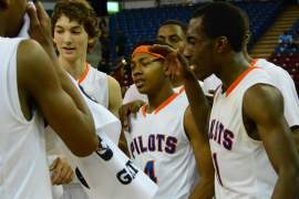 Photo by Tomas Pineda James Bramble, Elijah Fisher and Marcus Harris huddle up during the CIF State Championship.
